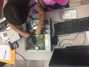 A student tries their hand at replacing RAM.